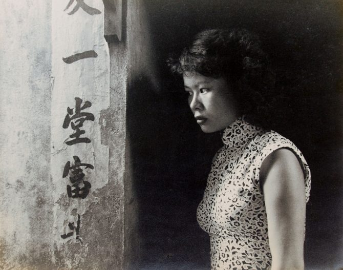 Teng NanKuang, A Girl of Back Alley, 1960's, gelatin silver print 30 x 37.8 cm signed and titled in Chinese and English on verso