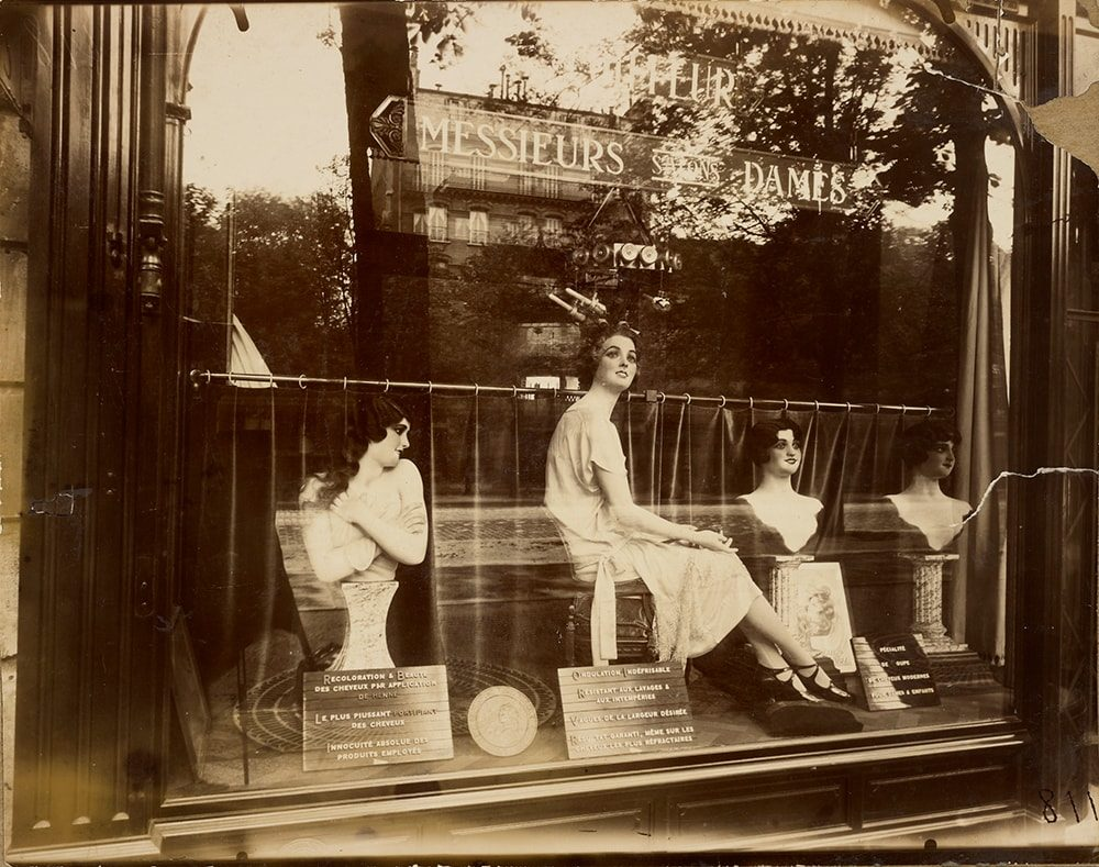 Eugène Atget (French, 1857 - 1927) [Salon de Coiffure (Hairdresser's Shop)], 1926, Gelatin silver chloride printing-out paper print 18.1 × 22.9 cm (7 1/8 × 9 in.), 90.XM.64.21 The J. Paul Getty Museum, Los Angeles