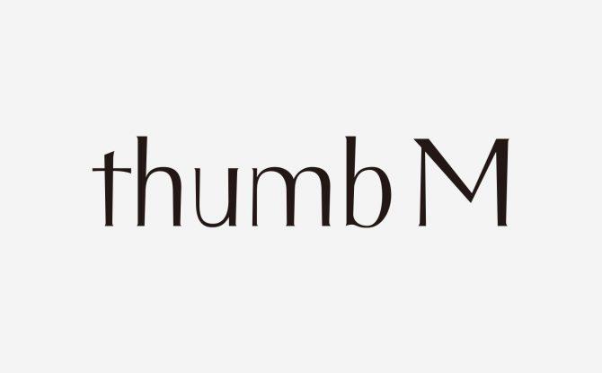 有限会社thumb M