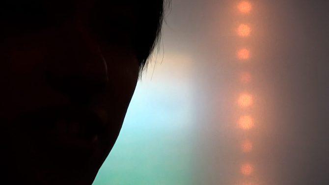 Shibboleth—I peep the ocean through a hole of the torn cardigan Single Channel Color Video © Eiki Mori Courtesy KEN NAKAHASHI